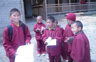 young monks going to school